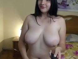 Defnie amature cam girl strips and masturbates