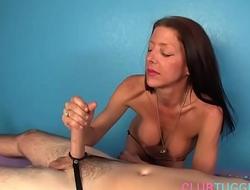 Busty milf gives handjob on a massage table