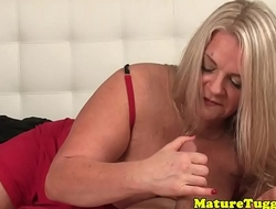 Handjob curvy mature tugging dick in pov